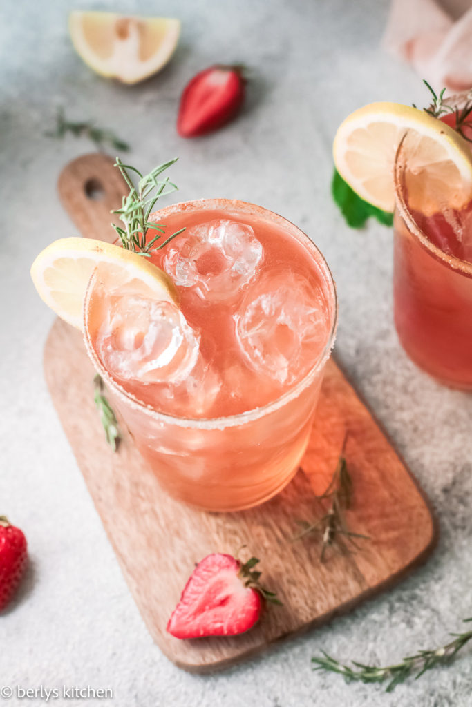 Top down view of strawberry drinks in glasses.