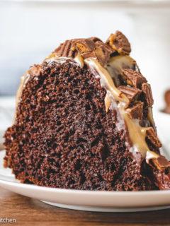 Slice of chocolate bundt cake with peanut butter sauce.