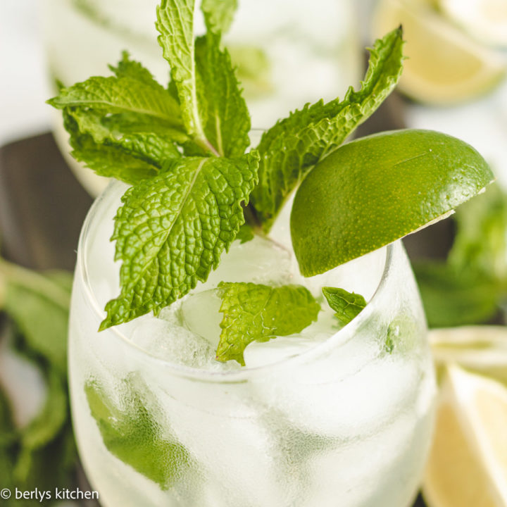 Close up of a mojito with fresh mint and lime.