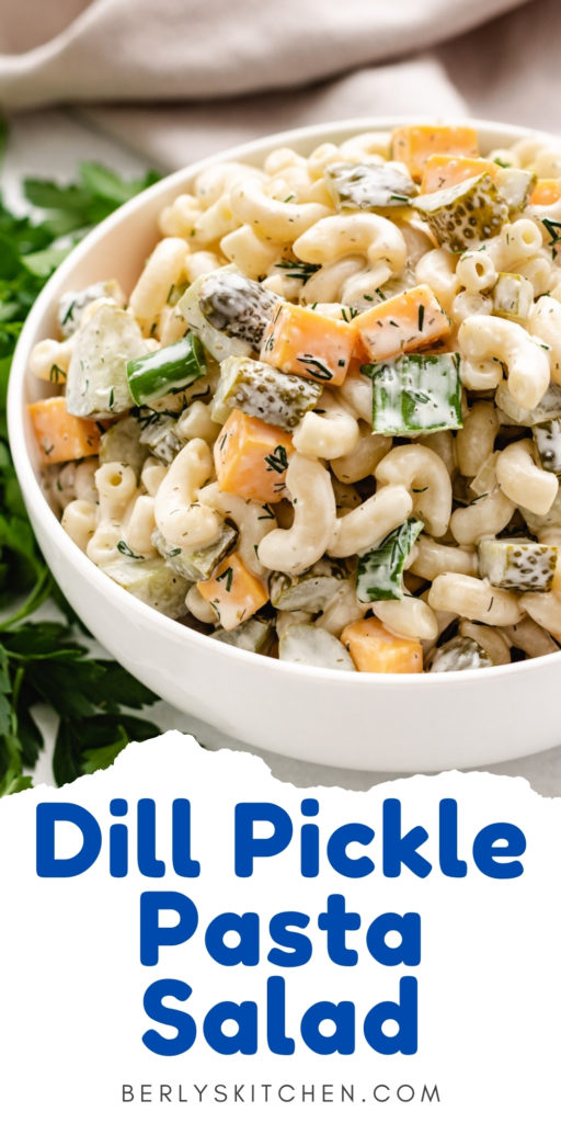Dill pickle pasta salad in a white bowl.