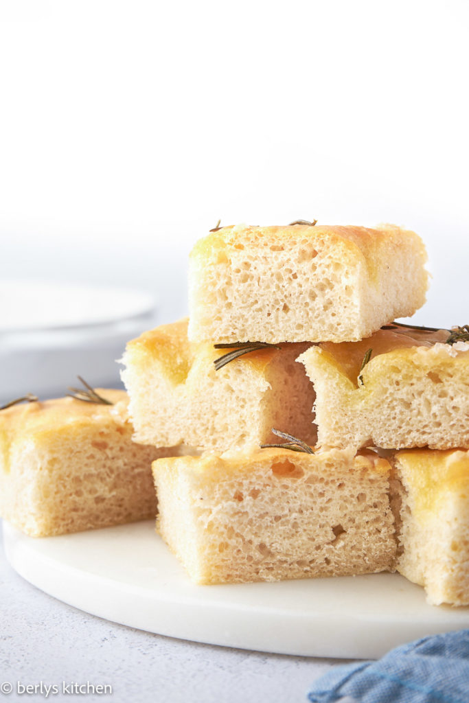 Close up of focaccia squares on a white plate.