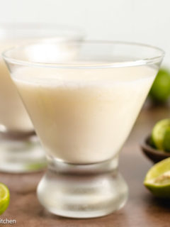 Two glasses of key lime martini with heavy cream.