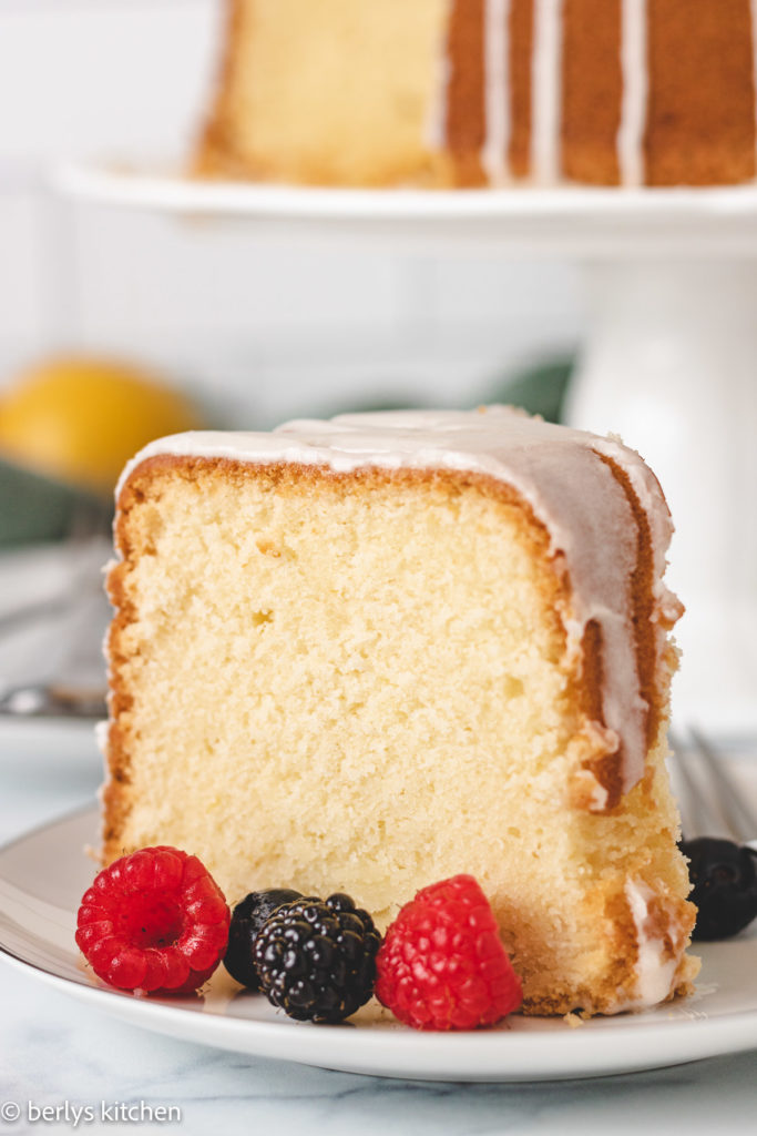 Slice of pound cake on a white dish.