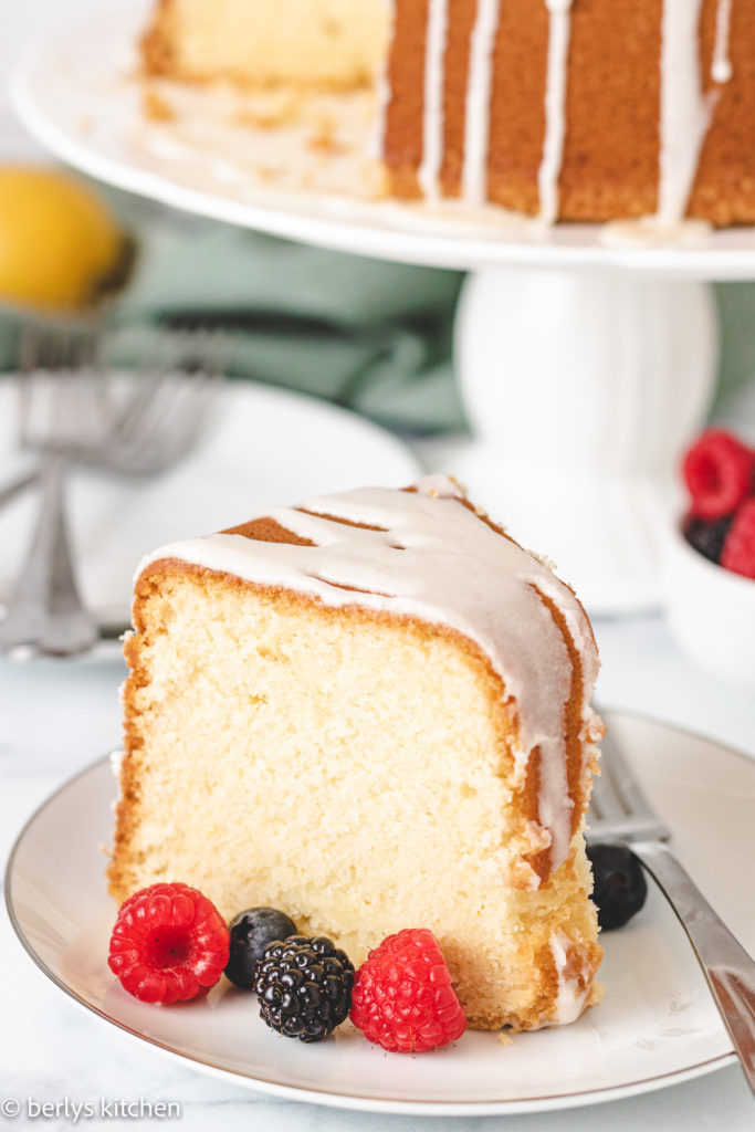 Lemon pound cake and berries on a plate.