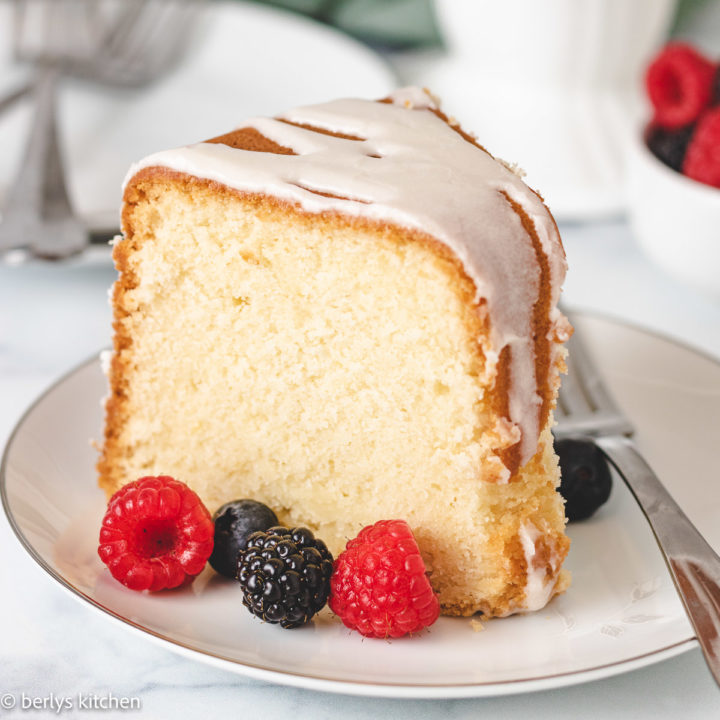 Slice of lemon pound cake with fresh berries.