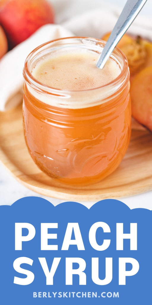 Jar of peach syrup on a small plate.
