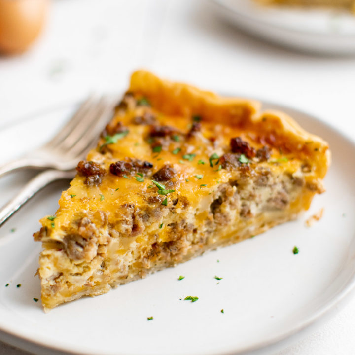 Slice of sausage quiche on plates.