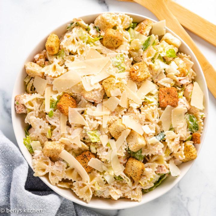 Chicken caesar pasta salad in a serving dish.