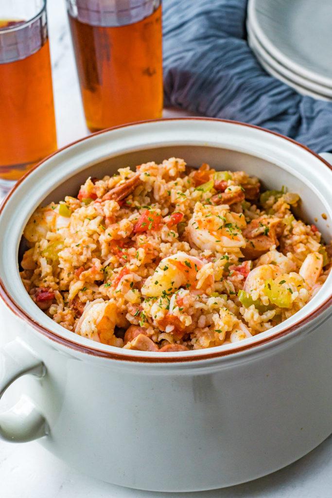 Gray bowl with shrimp and sausage jambalaya.