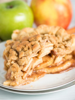 Dutch apple pie on a white plate.