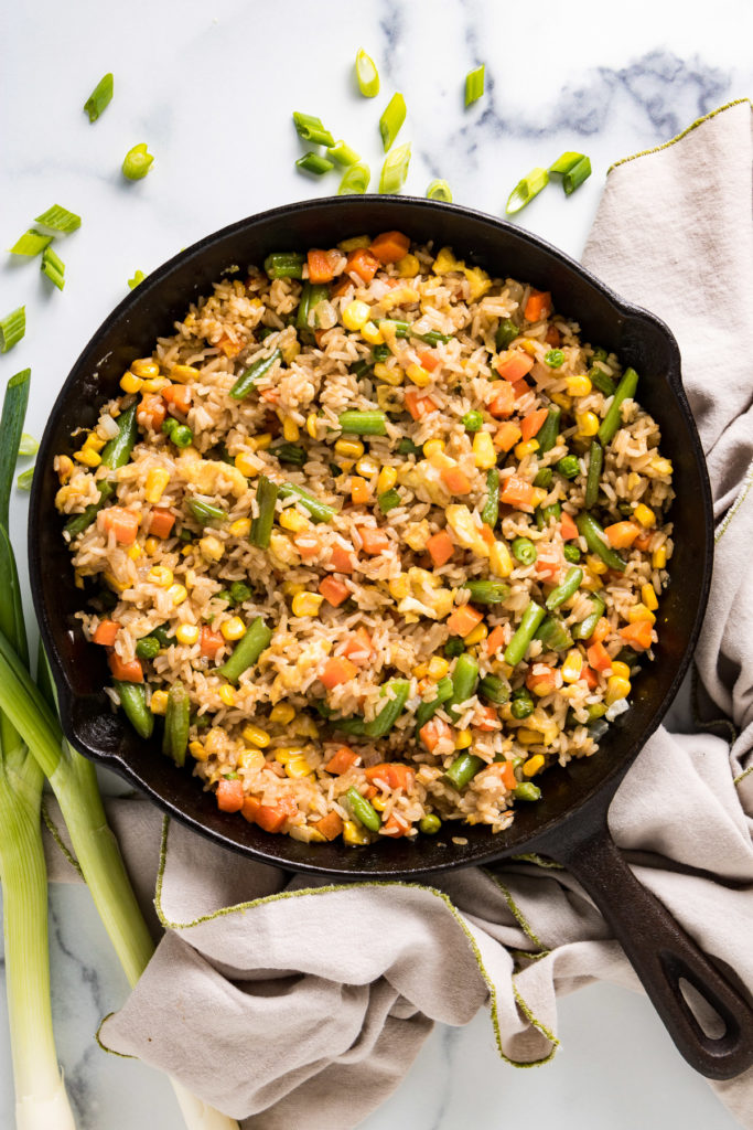 Top down view of fried rice in a pan.