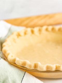 All butter pie crust in a pie dish.