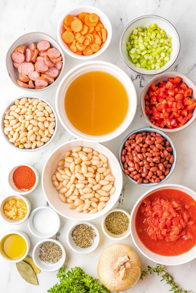 Top down view of ingredients for sausage and bean soup.