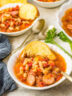 White bowl filled with bean soup.