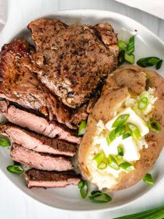 Top down viewSirloin Steak and bake potato with green onions.