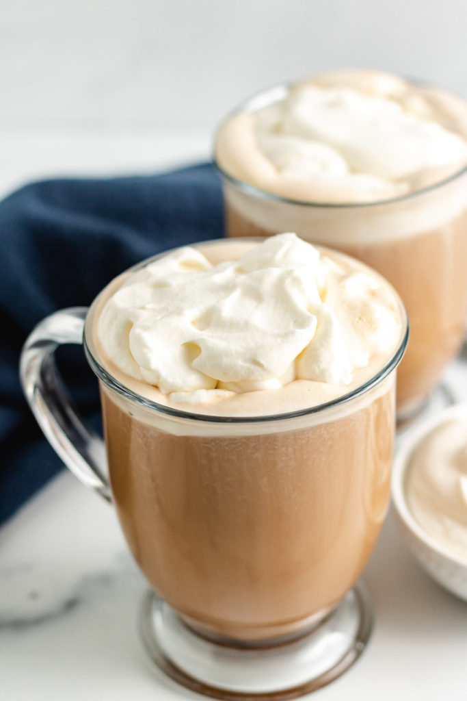 Two amaretto coffees with whipped cream.