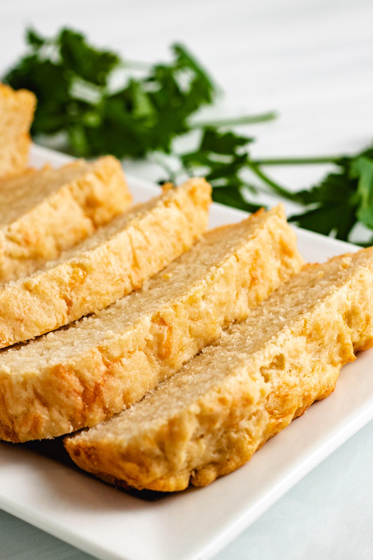 Sliced beer bread on a white platter.