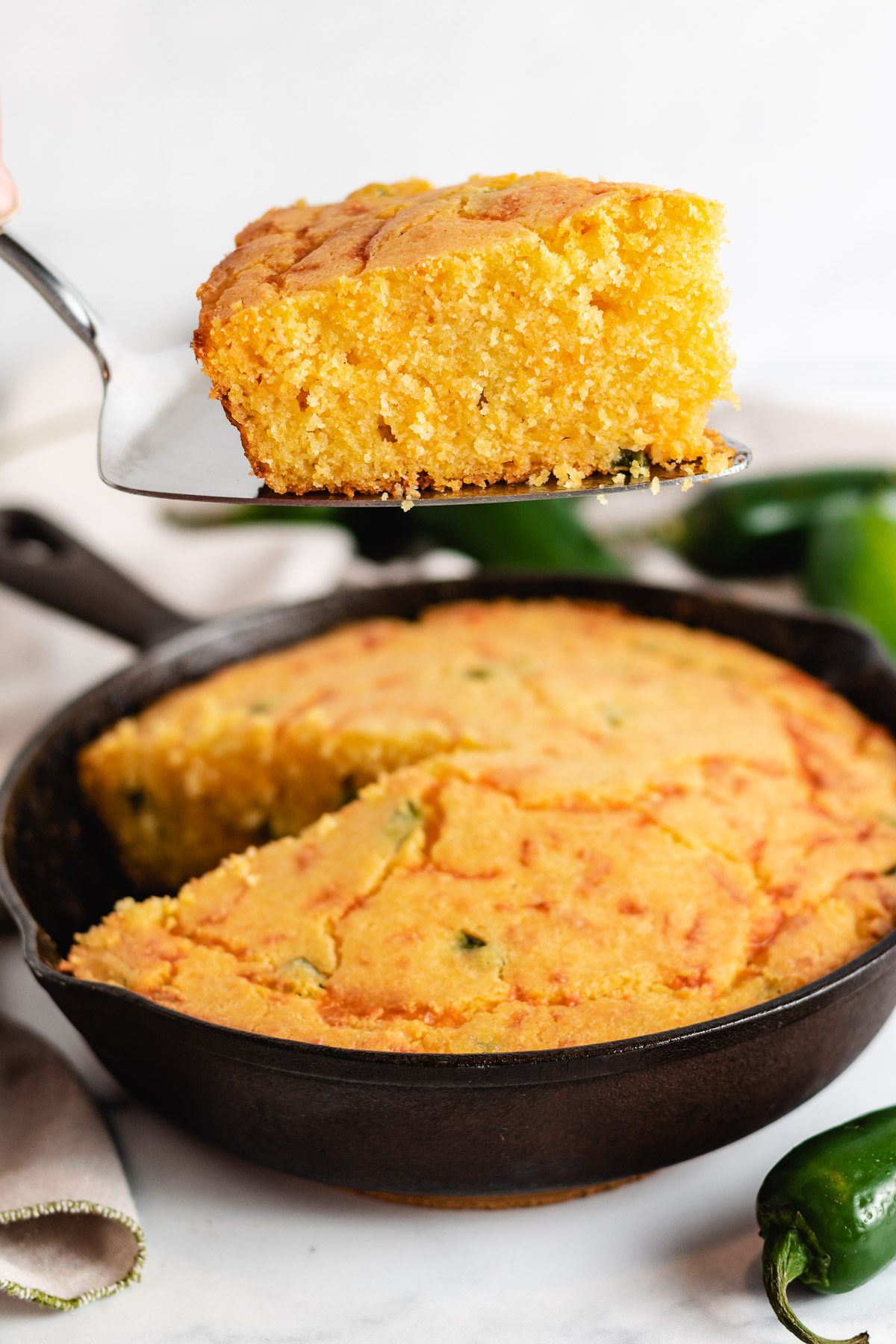 Cast iron skillet filled with spicy cornbread.