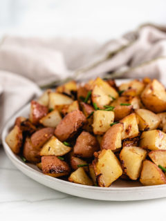 Serving plate with roasted potatoes.
