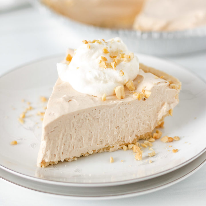 Slice of peanut butter pie with crushed peanuts.