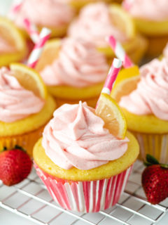 Lemonade cupcakes in pink and white liners.