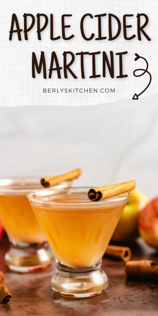 Two glasses of apple cider martini with a cinnamon stick.