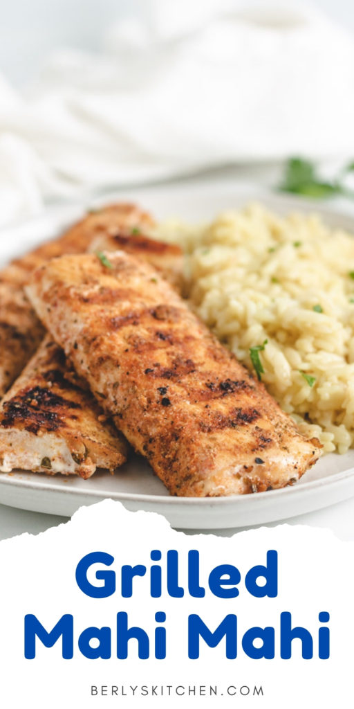 Grilled mahi mahi fillets on a plate with rice pilaf.