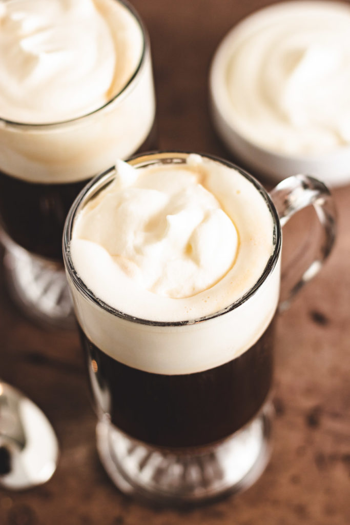 Top down view of irish coffee with whipped cream.