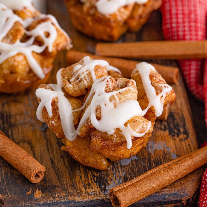 Cinnamon roll monkey bread roll with drizzle.