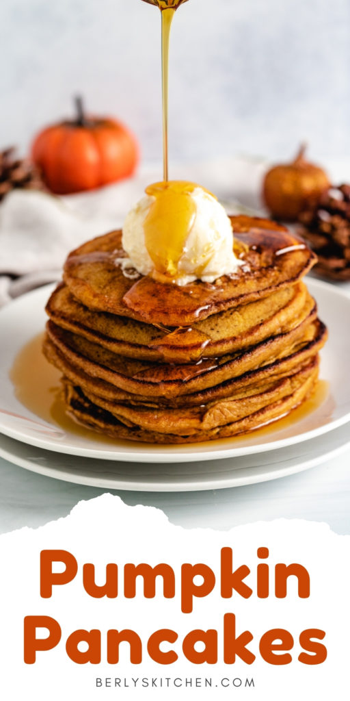 Stack of pumpkin pancakes with syrup.