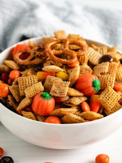 Serving dish filled with snack mix and candy.