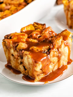 Top down view of pumpkin bread pudding with caramel on a serving dish.