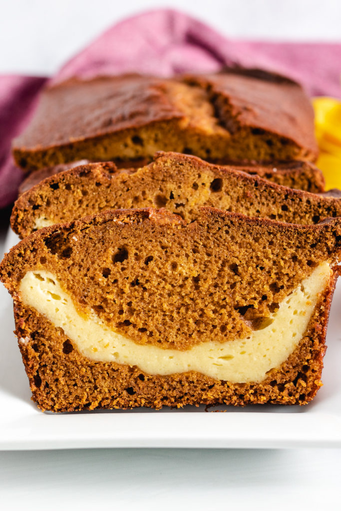 Pumpkin bread with cream cheese in the center.