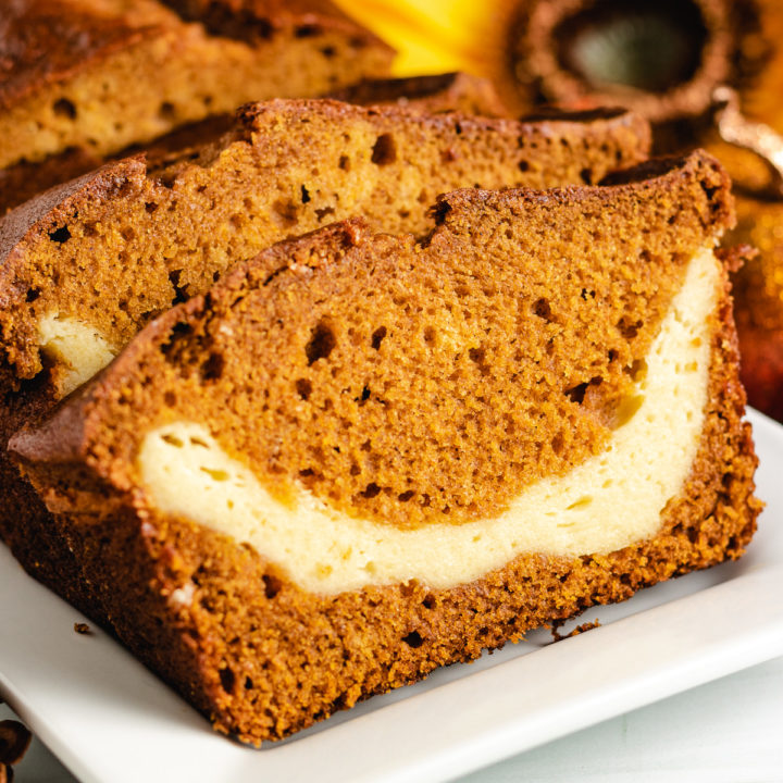 Sliced pumpkin bread with cream cheese in the center.