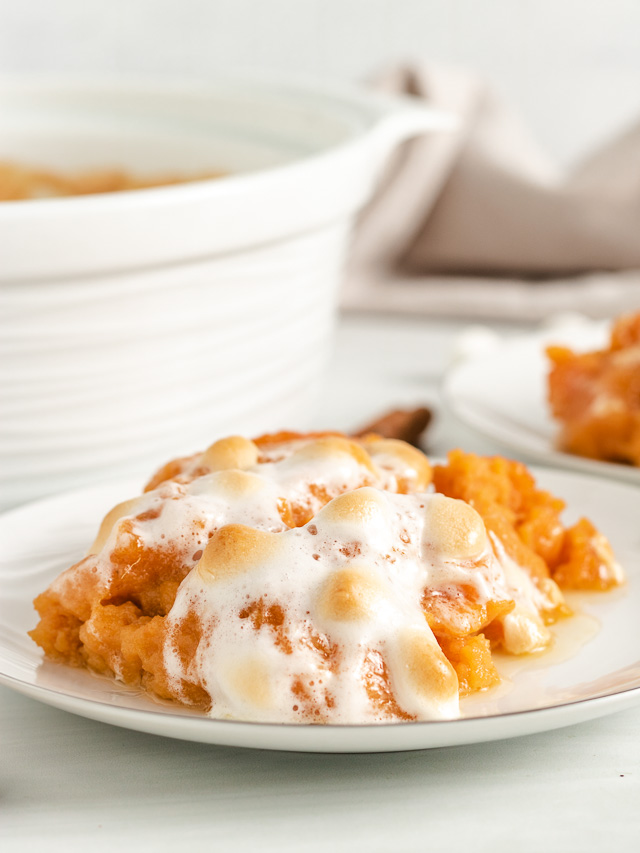 Sweet potato casserole with marshmallows on a plate.